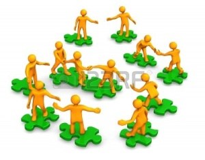 9928261-orange-dibujos-animados-en-los-puzzles-verdes-simbolizan-un-trabajo-en-equipo